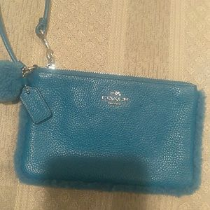 Coach shearling & leather wristlet
